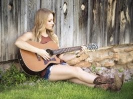 female acoustic guitar player
