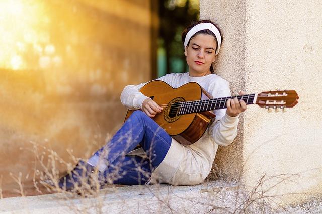 girl wearing headband playing guitar