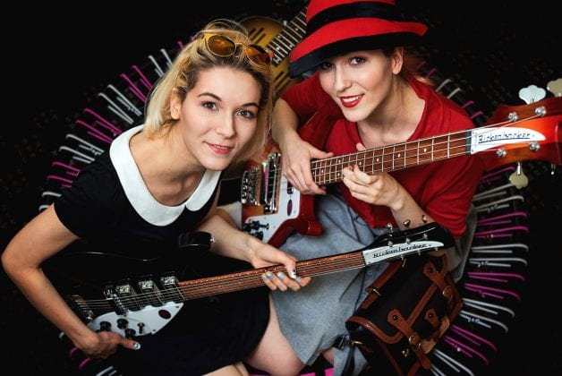 MonaLisa Twins Jumping with guitars