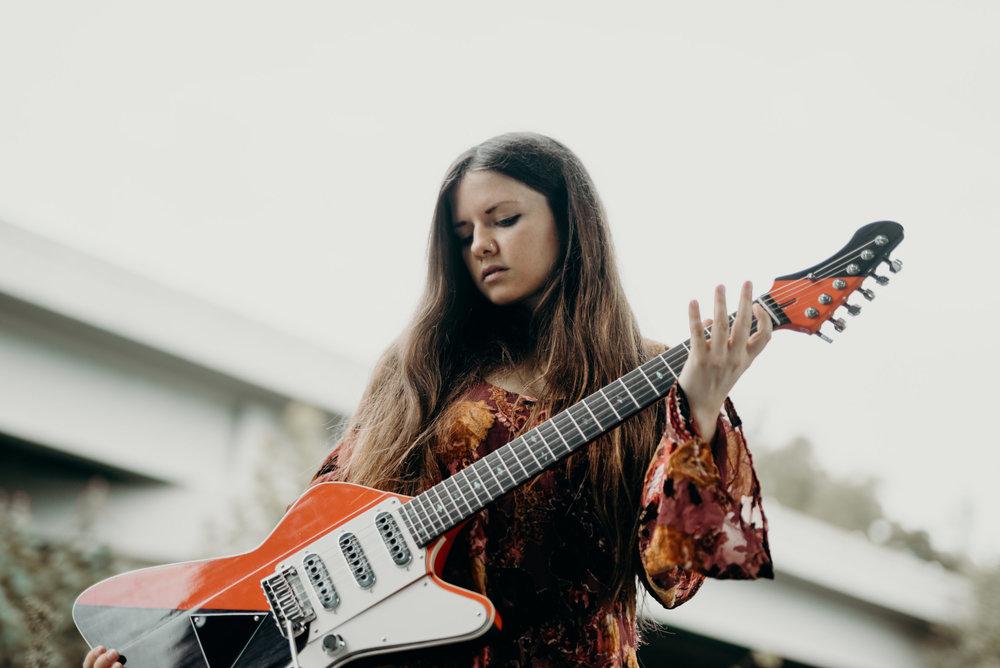 singer songwriter guitarist arielle