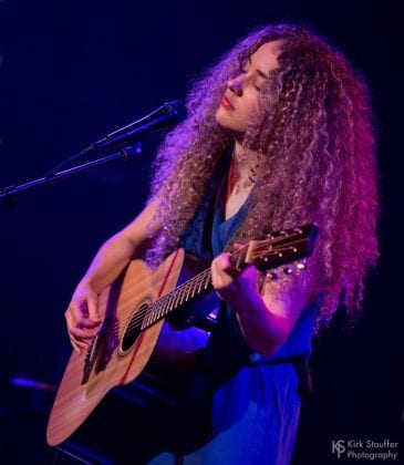 Tal Wilkenfeld playing acoustic guitar