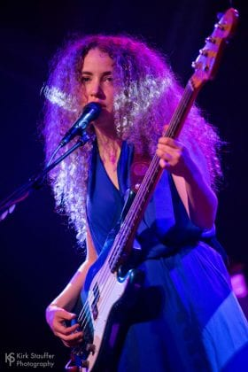 Tal Wilkenfeld onstage with Fender bass guitar