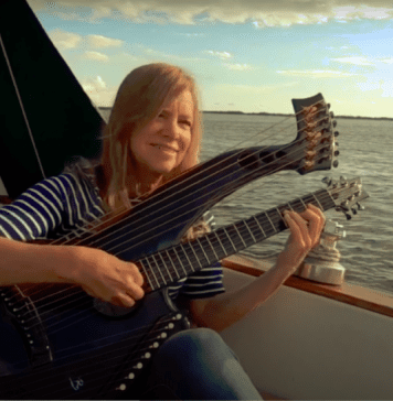 woman on boat playing guitar